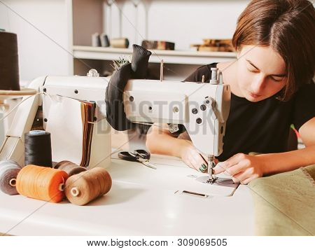 Bespoke Service. Tailor Workplace. Seamstress Sewing Clothes And Threading Needle.