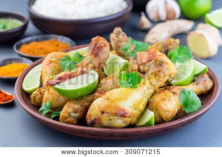 Indian Chicken Tandoori, Marinated In Greek Yogurt  And Spices, Served With Lime Wedges And Cilantro