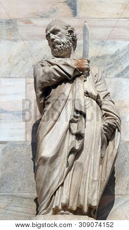 MILAN, ITALY - JUNE 22, 2018: Saint Bartholomew the Apostle, statue on the Milan Cathedral, Duomo di Santa Maria Nascente, Milan, Lombardy, Italy