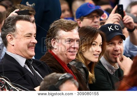 NEW YORK-FEB 10: (L-R) Actors Tom Hanks, Christopher McDonald, Olivia Wilde & Jason Sudeikis attend New York Knicks and Los Angeles Clippers game at Madison Square Garden on February 10, 2013.