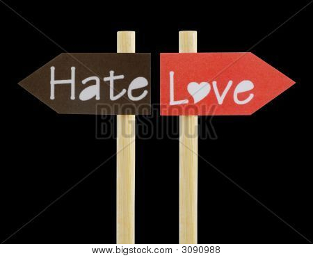 Imitation signboard showing the opposite directions for Love and Hate perfectly isolated on black poster