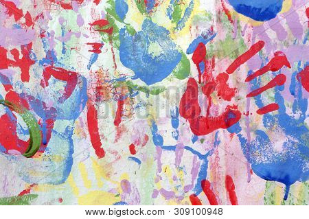 Color Background Of Children's Handprints. Multi Colored Hand Prints