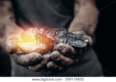 Miner Holds Coal, Palm Texture. Concept Mining, Black Stone.