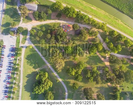 Aerial View Busy Parking Lots At Trailhead Of Urban Park With Playground, Pathway In Houston
