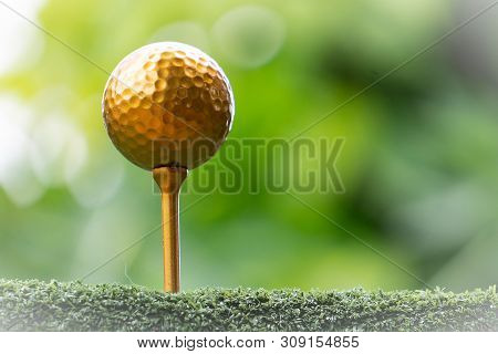 Golf Golf Ball And Pins Gold Against The Background Of Natural Beauty, The Ultimate Victory Of Golf