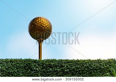 Gold Golf Ball And Pins With A Bright Sky, The Ultimate Victory Of Golf
