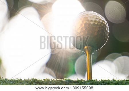 Gold Golf Ball And Pins With A Bright Light, The Ultimate Victory Of Golf