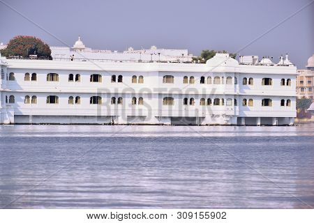 Udaipur, Rajasthan, India - 29 June 2019: Abstract Background Of Distant View Of Taj Lake Palace On