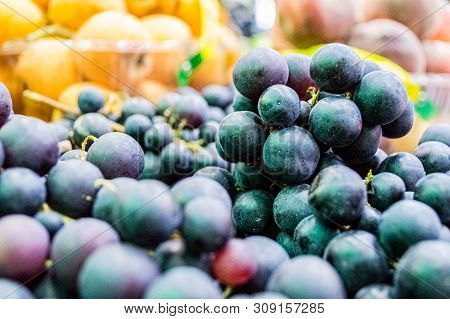 Close Up Of Delicious Organic Dark Blue Grapes For Sale In Supermarket.