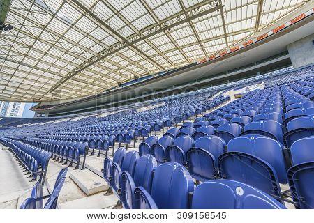 Porto, Portugal - April 2018: Blue Chairs In The Tribunes Of Estadio Do Dragao Stadium