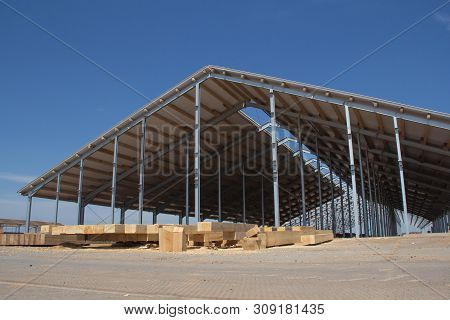 Construction Of Agricultural Facilities. Wooden Beams For The Construction Of The Roof Against The B