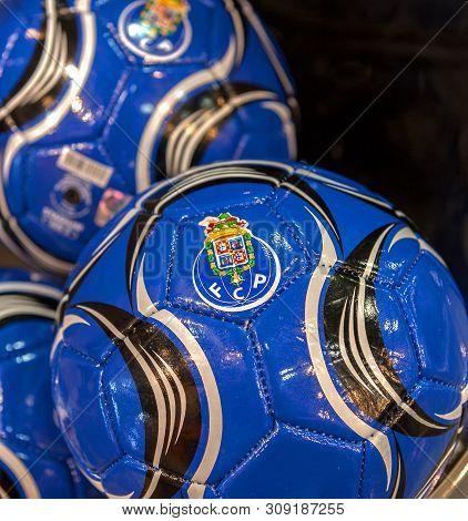 Porto, Portugal - April 2018: Balls On Sale In Fc Porto Fan Shop