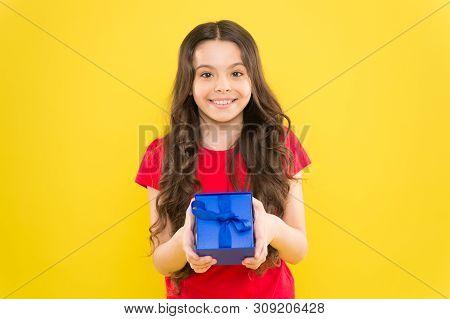 Happy Birthday To You. Birthday Girl. Happy Little Child Holding Birthday Gift On Yellow Background.