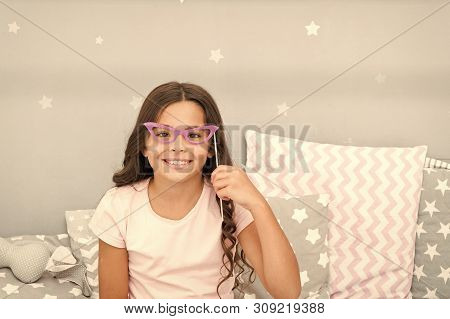 Slumber Party Photo Booth Props. Kid Girl Cheerful Posing With Retro Pink Eyeglasses Party Attribute