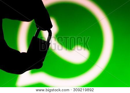 June 30, 2019, Brazil. In This Photo Illustration Whatsapp Security Concept. Silhouette Of A Hand Ho