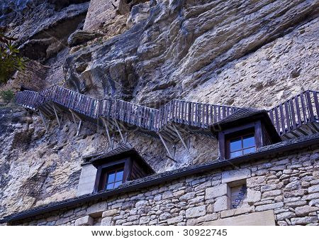 Steep steps hug the cliffs above the village of La Roque-Gageac