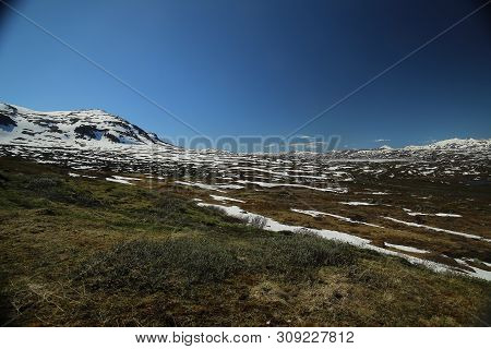 Mountains, Grassland And Rocks At The Valley Karkevagge In Northern Sweden