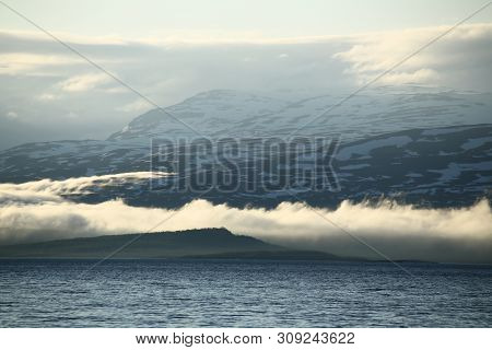 Clouds Creeping Over Hills At The Tornetrask In Sweden