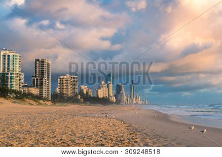 Sunrise At Gold Coast Beach In Australia. Beautiful Morning Light Over Tropical Beach Coastline