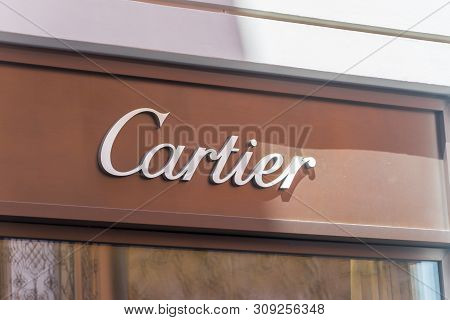 Lugano, Switzerland - June 1, 2019: Sign Of Luxury Store Cartier. Cartier Is A French Luxury Goods C