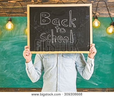 Start Of School Year Concept. Teacher Faceless Holds Blackboard With Title Back To School. Man Welco