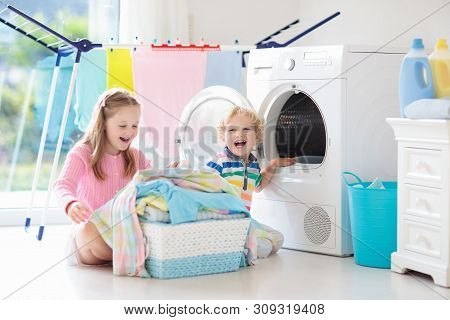 Kids In Laundry Room With Washing Machine