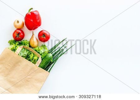 Buying Fresh Vegetables In Paper Bag On White Background Top View Copyspace