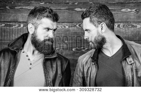 Confident competitors strict glance. Masculinity concept. Masculinity attributes. Brutality confidence and masculinity interconnection. True man temper. Men brutal bearded hipster. Exude masculinity poster