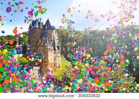Eltz Castle In Germany With Many Air Balloons Fly