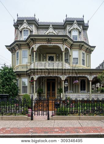Cape May, Nj - 12 June 2019: Victorian Painted Wooden Homes In The Historic Downtown Area Of The Cit