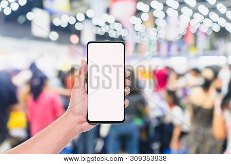 Mobile Phone Mockup Image, Hand Holding Blank Screen Mobile Smart Phone With Blurred  Crowd Of Peopl
