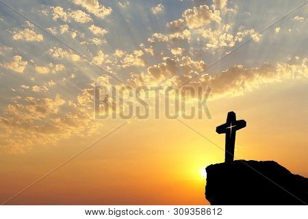 Silhouette Of Jesus Christ Crucifix On Cross Over Sunset.concept For Catholic Religion, Christian Wo
