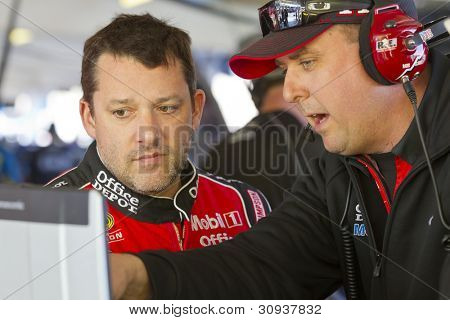 Avondale, Az - Mar 02, 2012:  Tony Stewart (14) Talks With His Crew During A Practice Session For Th