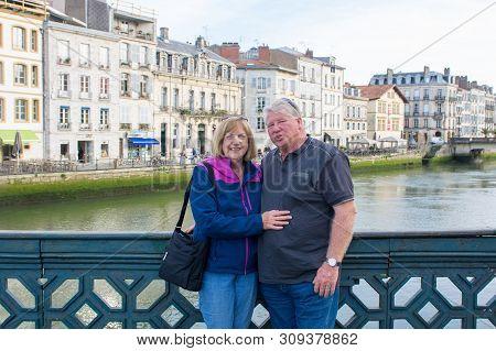 Senior Couple Traveling Around Europe Enjoying Retirement Lifestyle And Freedom. In Healthy Active O