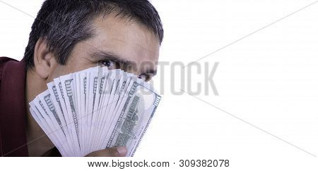 Man Holding A Widespread Of One Hundred Dollar Bills Covering His Face Looking Directly At Camera Gr