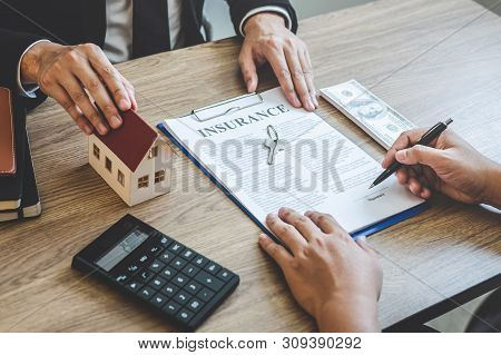 Estate Agent Giving House And Keys To Client After Signing Agreement Contract Real Estate With Appro