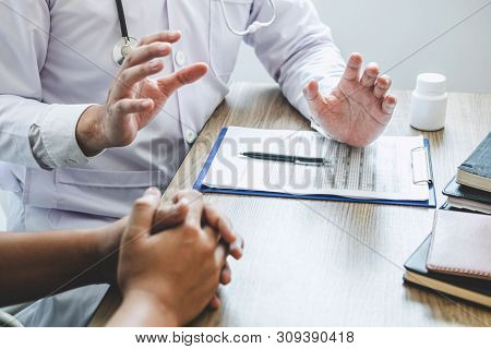 Doctor Consulting With Patient Examining For Patient, Presenting Results Symptom About The Problem A