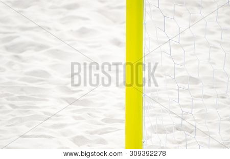 Football Summer Sport. Closeup Goal Net On A Sandy Beach Outdoor