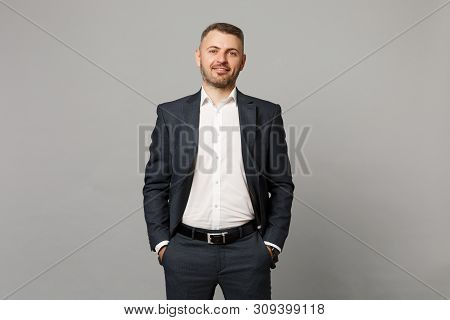 Handsome Successful Confident Young Business Man In Classic Black Suit Shirt Posing Isolated On Grey