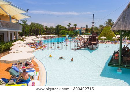 Side, Turkey - June 12, 2018: Beautiful pool area of the TT Pegasos World resort near Side, Turkey. Pegasos World Hotel is a 4-star resort with 9600 square metres of pool areas.