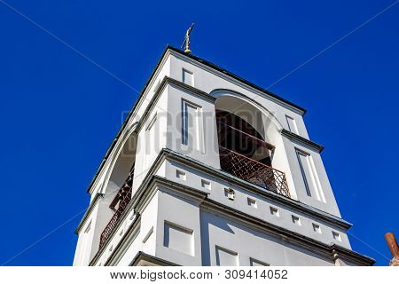 The Belltower Of The Church Of St. Nicholas The Wonderworker Of The 19th Century In The Village Of O