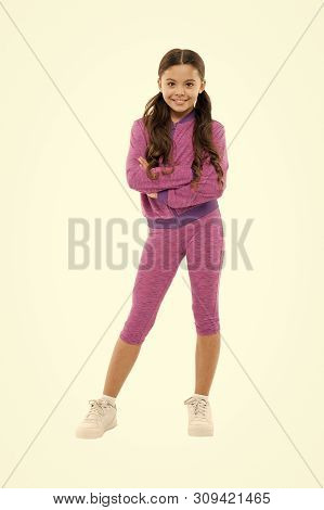 poster of Girl cute kid with long ponytails wear sportive costume isolated on white. Sport for girls. Guidance on working out with long hair. Deal with long hair while exercising. Working out with long hair.