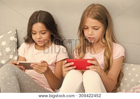 Children In Pajama Interact With Smartphones. Application For Kids Fun. Internet Surfing And Absence