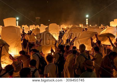 Chiang Mai, Thailand - October 25, 2014: People Preparing To Release Sky Lanterns During Yi Peng Fes