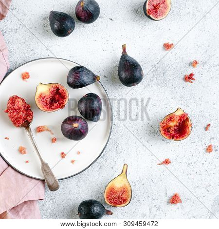 Half And Whole Figs On Gray Cement Background. Ripe Violet Figs With Copy Space For Text. Figs Flesh