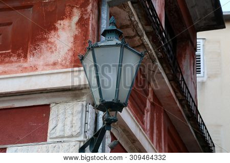 Old Street Lamps Illuminate The Way For Passersby.