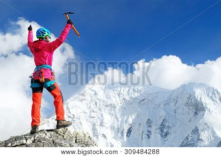 Climber Reaches The Summit Of Mountain Peak. Nepal, Everest Region. Success, Freedom And Happiness,