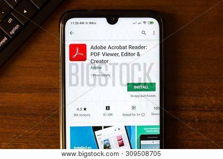 Ivanovsk, Russia - June 26, 2019: Adobe Acrobat Reader App On The Display Of Smartphone Or Tablet.