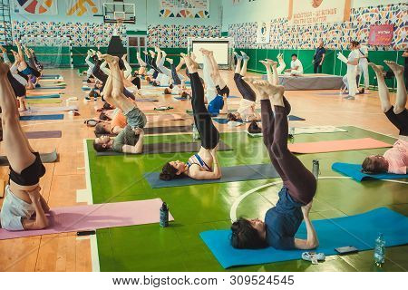 Kyiv, Ukraine: Yoga Class With Active People Making Practice Of Simple Asanas Together, Training In