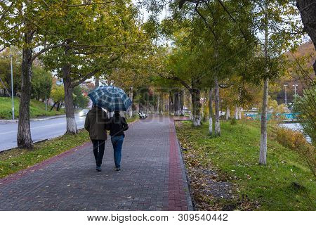 Petropavlovsk-kamchatsky, Russia- 05 October 2014: People On The Alley In The Park At Lenin Street.
